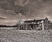 This abandoned home is about halfway between Manning and Sardinia South Carolina. Abandoned and deserted homes dot the landscape of well traveled South Carolina roads. I find that abandoned buildings have a certain air of mystery and romance and make excellent photo subjects. This one is located on Rt301.