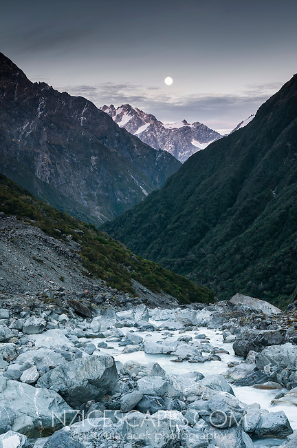 Full moon, Southern Alps and rocky Butler River near Ice Lake, Westland National Park, West Coast, New Zealand