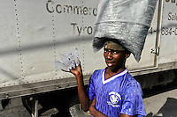 A Haitian boy sells safe drinking water in plastic bags on the street of Port-au-Prince, Haiti, 7 July 2008. Although Latin America (as a whole) is blessed with an abundance of fresh water, having 20% of global water resources in the the Amazon Basin and the highest annual rainfall of any region in the world, an estimated 50-70 million Latin Americans (one-tenth of the continent's population) lack access to safe water and 100 million people have no access to any safe sanitation. Complicated geographical conditions (mainly on the Pacific coast), unregulated industrialization (causing environmental pollution) and massive urban poverty, combined with deep social inequality, have caused a severe water supply shortage in many Latin American regions.