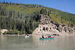 Canoeists float a placid stretch of the lower Kechika River in the Muskwa-Kechika Management Area of northeast British Columbia, Canada