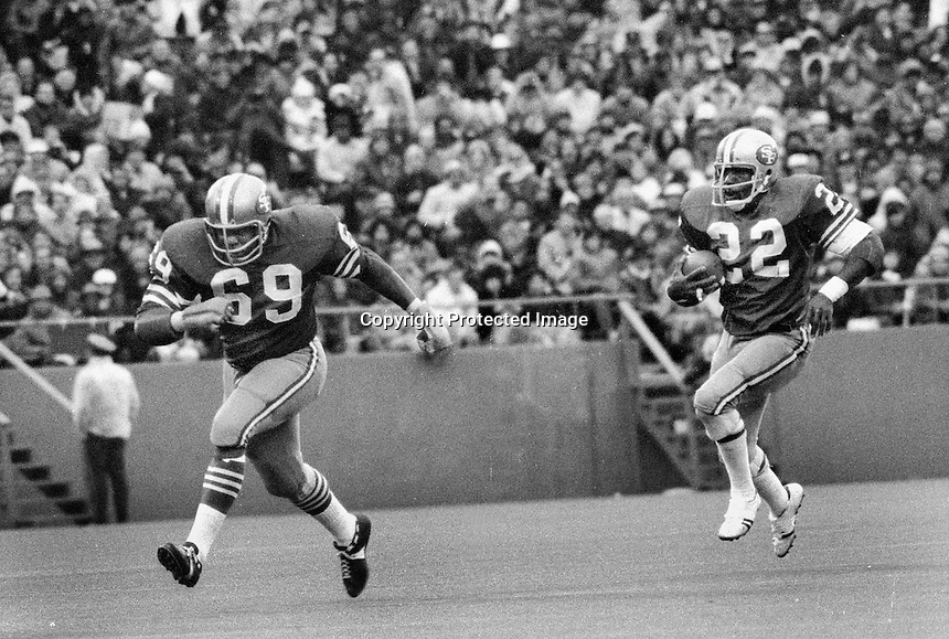 San Francisco 49er Gary Lewis #22 running with blocker #69..(1971 playoff game against the Washington Redskins)...(photo/Ron Riesterer)