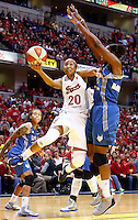 INDIANAPOLIS, IN - OCTOBER 21: Briann January #20 of the Indiana Fever shoots the ball against Taj McWilliams-Franklin #8 of the Minnesota Lynx during Game Four of the 2012 WNBA Finals on October 21, 2012 at Bankers Life Fieldhouse in Indianapolis, Indiana. NOTE TO USER: User expressly acknowledges and agrees that, by downloading and or using this Photograph, user is consenting to the terms and conditions of the Getty Images License Agreement. (Photo by Michael Hickey/Getty Images) *** Local Caption *** Briann January; Taj McWilliams-Franklin