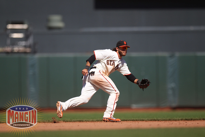 SAN FRANCISCO, CA - MAY 20:  Brandon Crawford #35 of the San Francisco Giants chases a ground ball against the Oakland Athletics during the game at AT&T Park on Sunday, May 20, 2012 in San Francisco, California. Photo by Brad Mangin