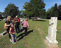 STAFF PHOTO ANDY SHUPE - Visitors check out the restored grave markers during a dedication ceremony Sunday, Sept. 21, 2014, for the Gehring Cemetery at Christian Life Cathedral in Fayetteville.
