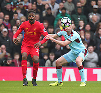 Liverpool's Divock Origi and Burnley's Michael Keane<br /> <br /> Photographer Rich Linley/CameraSport<br /> <br /> The Premier League - Liverpool v Burnley - Sunday 12 March 2017 - Anfield - Liverpool<br /> <br /> World Copyright &copy; 2017 CameraSport. All rights reserved. 43 Linden Ave. Countesthorpe. Leicester. England. LE8 5PG - Tel: +44 (0) 116 277 4147 - admin@camerasport.com - www.camerasport.com