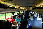 Riders on an AMTRAK train from Philadelphia..Philadelphia, Pennsylvania, PA USA.  Photo copyright Lee Foster, 510-549-2202, lee@fostertravel.com, www.fostertravel.com. Photo 355-30736