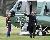 United States President Barack Obama waves to supporters as he arrives on the South Lawn of the White House in Washington, D.C. following a quick trip to Cleveland, Ohio to discuss the economy..Credit: Ron Sachs / Pool via CNP