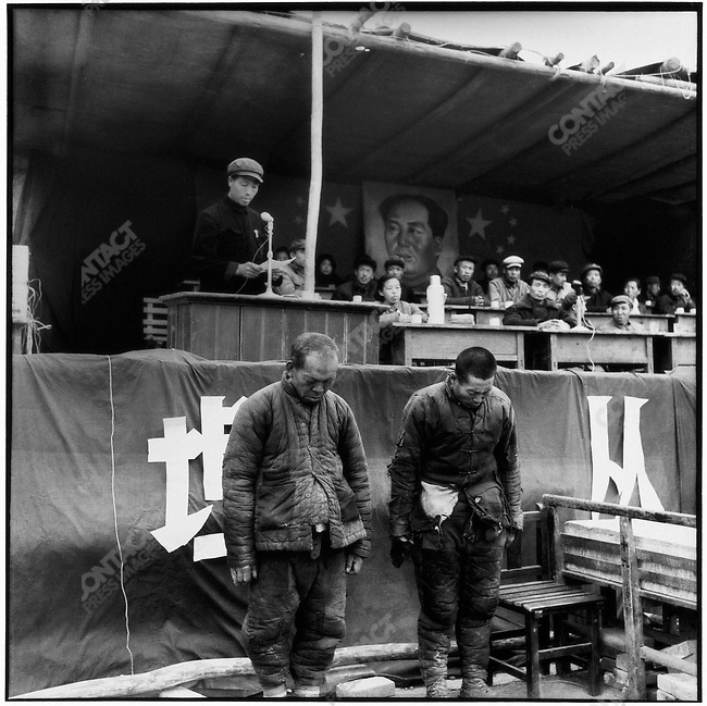 Yuan Fengxiang and Deng Guoxing (left and right) are made to stand with their heads bowed while being sentenced to two years of hard labor. Ashihe commune, Acheng county, 12 May 1965
