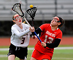 CHESHIRE, CT-042517JS13- Cheshire's Mikayla Crowley (3) and Branford's Sabrina Torcellini (13) battle for the ball during their game Tuesday Cheshire High School. <br /> Jim Shannon Republican-American