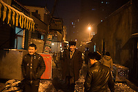 Uighurs walk through the streets of the Uighur section of Urumqi, Xinjiang, China.  The city is divided between Han and Uighur ethnicities, and violent clashes erupted between the groups in 2009.