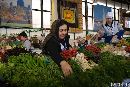 A Georgian vegetable vendor works at the Rishski Market in Moscow. A law came into effect in 2007 barring foreigners from trading in Russian markets.