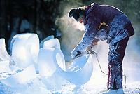 Ice sculptor uses a grinding tool to shape giant blocks of ice during the World Ice Art Championships held each march in Fairbanks, Alaska,