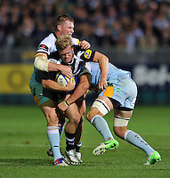 Michael Claassens is double-tackled in possession. Aviva Premiership match, between Bath Rugby and Northampton Saints on September 14, 2012 at the Recreation Ground in Bath, England. Photo by: Patrick Khachfe / Onside Images