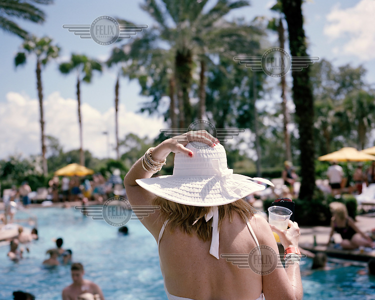 A woman holding her drink during the pool party, at the 2013 Panama Canal Society Reunion, at the Marriott hotel in Orlando, Florida.