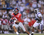 Ole Miss wide receiver Donte Moncrief (12) gets away from Central Arkansas' Dominique Brown (8) to score at Vaught-Hemingway Stadium in Oxford, Miss. on Saturday, September 1, 2012. Mississippi won.