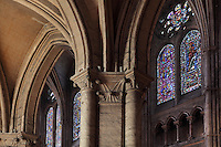 Columns and capitals of the narthex with the nave beyond, with its stained glass windows, Chartres Cathedral, Eure-et-Loir, France. Chartres cathedral was built 1194-1250 and is a fine example of Gothic architecture. It was declared a UNESCO World Heritage Site in 1979. Picture by Manuel Cohen