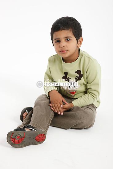 Asian boy in studio portrait