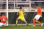 16 November 2007: A Boston College shot deflects off Virginia Tech's James Shupp (4) and past Virginia Tech goalkeeper Markus Aigner (26) during first half play.  Boston College defeated Virginia Tech 3-1 at SAS Stadium in Cary, NC in an Atlantic Coast Conference Men's Soccer tournament semifinal.