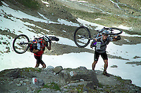 Verwall Gruppe, Ischgl, Austria, July 2004. To mountainbikers turn around. The pass is too high. Trekking from hut to hut in the Verwall Gruppe is a strenuous adventure, however no knowledge of technical mountaineering is necessary. Photo by Frits Meyst/Adventure4ever.com