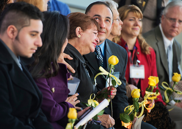 UNITED STATES - MAY 13: Alex Mora, and his mother Luz Jimenez attend a ceremony at the Newseum to honor journalists who died in the line of duty. The names of 82 journalists who died in 2012 were added to the Journalists Memorial. Mora's father and Jimenez's husband, Alirio Mora, was killed in Colombia in 1983. (Photo By Tom Williams/CQ Roll Call)