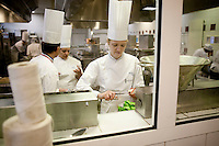 A student prepares ingredients at the start of a class at the Ecole Superieure de Cuisine Francaise Gregoire Ferrandi cooking school in Paris, France, 18 December 2007.