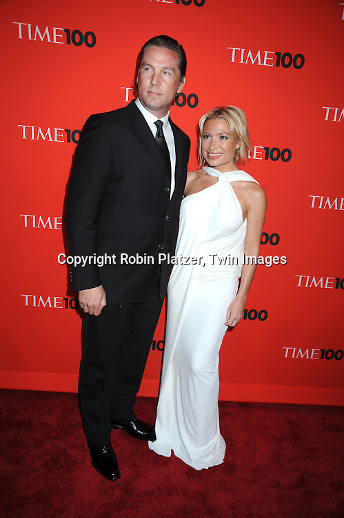 Tracy Anderson and boyfriend posing for photographers at the Time Celebrates the Time100 Issue Gala on May 4, 2010 at The Time Warner Center in New York City. The magazine celebrates the 100 Most Influential People in the World.