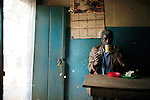 MPHANDULA, MALAWI - AUGUST 20: An unidentified old man drinks tea early in the morning in a tea house on August 20, 2006 in Mphandula village, about 30 miles outside Lilongwe, Malawi. Mphandula is a poor village in Malawi, without electricity or clean water. Nobody owns a car or a mobile phone. Most people live on farming. About 7000 people reside in the village and the chief estimates that there are about five-hundred orphans. Many have been affected by HIV/Aids and many of the children are orphaned. A foundation started by Madonna has decided to build an orphan center in the village through Consol Homes, a Malawi based organization. Raising Malawi is investing about 3 million dollars in the project and Madonna is scheduled to visit the village in October 2006. Malawi is a small landlocked country in Southern Africa without any natural resources. Many people are affected by the Aids epidemic. Malawi is one of the poorest countries in the world and has about 1 million orphaned children. (Photo by Per-Anders Pettersson)