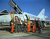Photo of the Mercury astronauts standing beside a Convair 106-B aircraft, taken on January 20, 1961. They are, left to right, M. Scott Carpenter, L. Gordon Cooper Jr., John H. Glenn Jr., Virgil I. Grissom, Walter M. Schirra Jr., Alan B. Shepard Jr., and Donald K. Slayton. .Credit: NASA via CNP