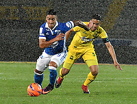 BOGOTA - COLOMBIA - 12 - 02 - 2017: Cristian Arango (Izq.) jugador de Millonarios disputa el balón con Yulian Anchico (Der.) jugador de Atletico Bucaramanga, durante partido de la fecha 3 entre Millonarios y Atletico Bucaramanga, de la Liga Aguila I-2017, jugado en el estadio Nemesio Camacho El Campin de la ciudad de Bogota.  / Cristian Arango (L) player of Millonarios vies for the ball with con Yulian Anchico (R) player of Atletico Bucaramanga, during a match between Millonarios and Atletico Bucaramanga, for the date 3 of the Liga Aguila I-2017 played at the Nemesio Camacho El Campin Stadium in Bogota city, Photo: VizzorImage / Luis Ramirez / Staff.