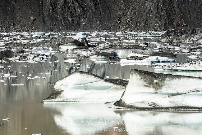 Floating icebergs on terminal lake of Tasman Glacier, Mt. Cook National Park, Mackenzie Country, New Zealand