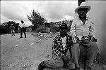 Zapotec neighbors attend a wedding ceremony in Coatecas Altas village, Oaxaca, November 22, 1998. Most of the villagers of Coatecas leave their home to harvest in northern state of Sinaloa.  © Photo by Heriberto Rodriguez
