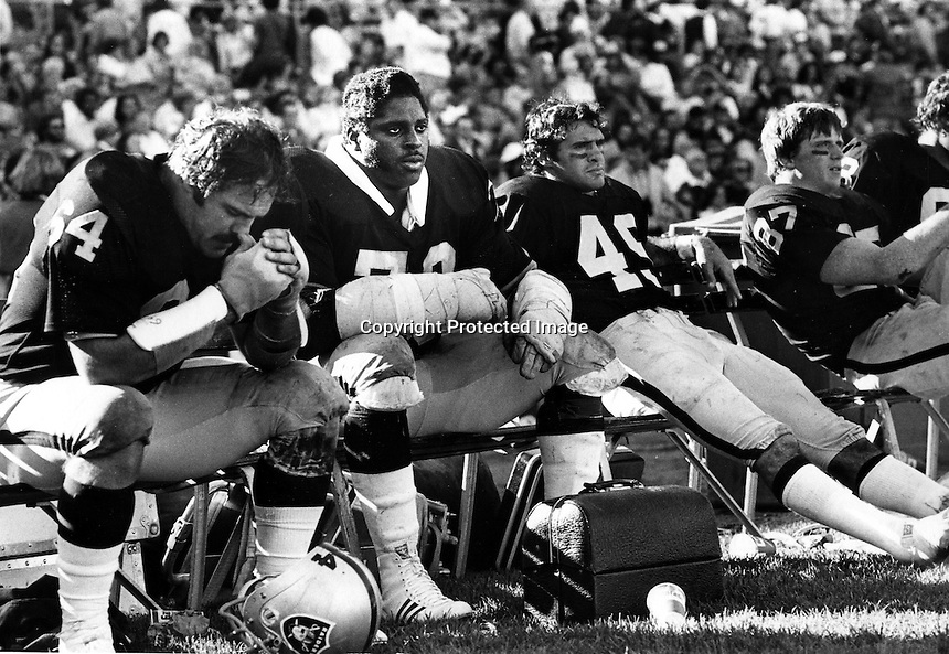 Raider bench dejected, George Buehler, Henry Lawrence, Mike Siani, and Dave Casper..Photo By Ron Riesterer