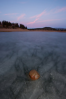 """Rock on Prosser Reservoir Sunset"" - Sunset photograph of a rock sitting on top of an icy frozen Prosser Reservoir in Truckee, CA."