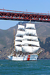 "The USCG Training Barque ""Eagle"" sails under the Golden Gate Bridge while leading the Parade of Ships during the 2008 San Francisco Festival of Sail. The 295' Training Barque Eagle was originally constructed  in 1936 at the Blohm and Voss Shipyards in Germany with the purpose of training U-Boat crews. The United States took possession of the vessel in 1946 as part of Germany's reparations for the war and it is currently used by the Coast Gaurd for training of United States Coast Guard Academy Cadets. The Eagle is the only active commissioned sailing vessel in the United States' government service. Photographed 07/08"