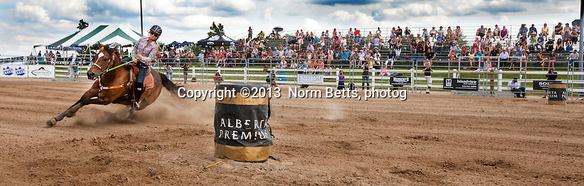 RAM Rodeo Tour, 21 July, 2013<br /> Rodeo action at Orangeville, Ontario, Canada<br /> Photo by Norm Betts <br /> tel:416 460 8743<br /> &copy;2013 Norm Betts, photog<br /> normbetts@canadianphotographer.com
