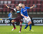 Hearts v St Johnstone....02.11.13     SPFL<br /> Tom Scobbie battles with Callum Paterson<br /> Picture by Graeme Hart.<br /> Copyright Perthshire Picture Agency<br /> Tel: 01738 623350  Mobile: 07990 594431