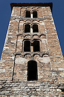 Low angle view of the bell tower of Santa Maria de Taull Church, 1123, consecrated by Ramon Guillem, the bishop of Roda, Taull, Province of Lleida, Catalonia, Spain. The bell tower is the oldest part of the church. Its four storeys are decorated with Lombard arches and mullioned windows. The church was heavily renovated in the 18th century. Santa Maria de Taull Church is part of the Catalan Romanesque churches of the Vall de Boí which were declared a World Heritage Site by UNESCO in November 2000. Picture by Manuel Cohen