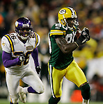 Donald Driver runs away from Antoine Winfield as he takes it to the house for his second touchdown of the night late in the second-quarter..The Green Bay Packers hosted the Minnesota Vikings in Monday Night Football at Lambeau Field in Green Bay, WI Monday November 21, 2005. WSJ/Steve Apps