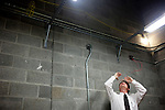 Kenny Harrison (left) is the Fire Safety Program Manager at Auburn University in Auburn, Alabama. He conducts an inspection of the construction of the school's new basketball arena November 18, 2009.