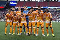 Foxborough, Massachusetts - August 15, 2015:  The New England Revolution (blue and white) vs Houston Dynamo (orange/white) at a Major League Soccer (MLS) match at Gillette Stadium.