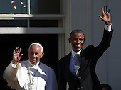 U.S. President Barack Obama (R) and Pope Francis (L) wave during an arrival ceremony at the White House on September 23, 2015 in Washington, DC. The Pope begins his first trip to the United States at the White House followed by a visit to St. Matthew's Cathedral, and will then hold a Mass on the grounds of the Basilica of the National Shrine of the Immaculate Conception. <br /> Credit: Win McNamee / Pool via CNP