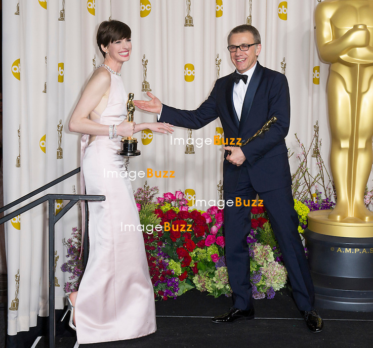 Anne Hathaway  and Christoph Waltz in the press room at the 85th Academy Awards at the Dolby Theatre, Los Angeles.