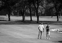 Jalen Rose and Ben Lyons talk while walking the golf course during the 5th annual Jalen Rose Leadership Academy golf tournament at the Detroit Golf Club in Detroit, Michigan on Monday August 31, 2015. (Photo by Jared Wickerham/The Players Tribune)
