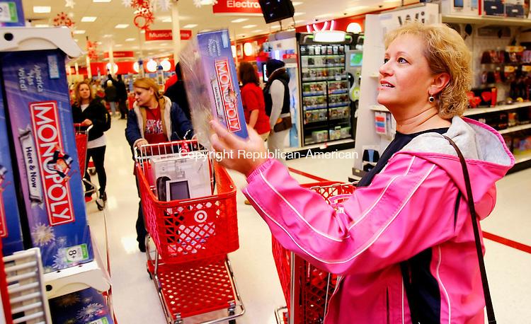 WATERBURY, CT. 24 November 2006--112406SV03--Joanne Thut of Waterbury shops for a game at Target in Waterbury Friday. <br /> Steven Valenti Republican-American