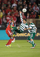 28 March 2012: Club Santos Laguna Osmar Mares #20 and Toronto FC midfielder Reggie Lambe #19 in action during a CONCACAF Champions League game between the Club Santos Laguna and Toronto FC at BMO Field in Toronto..The game ended in a 1-1 draw...