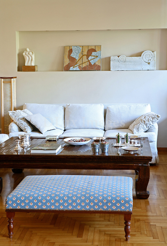 classic living room..Alina Matsa's detached house in Athens, Greece, stands out for its coziness and its positive aura.  It is decorated with many artworks which were painted by Ms. Matsa as well as other artists.