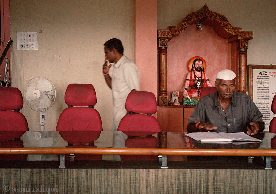 At the Kanifnath temple, the caretakers prepare a book for visitors