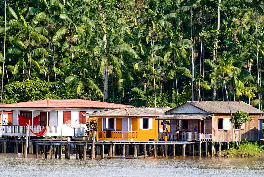 Houses on the bank of the Amazon River near Manaus, Brazil.: keithsherwood.photoshelter.com/image/I0000kEmTGIejENA