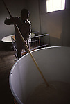 A worker stirs a mixture of Ingrediences that will make the popular rice wine at a sake factory near Hachinohe, Japan. (Jim Bryant Photo))......