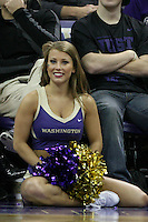 December 22, 2013:  Washington cheerleader Nikki Buchanan entertained fans during a timeout against Connecticut.  Connecticut defeated Washington 82-70 at Alaska Airlines Arena Seattle, Washington.